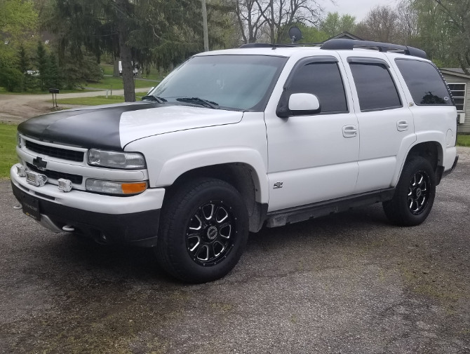 2002 Chevrolet  Tahoe Z71  4x4 with aftermarket rims and stereo system Goodyear Wrangler SR-A 265/65R18 (4914)